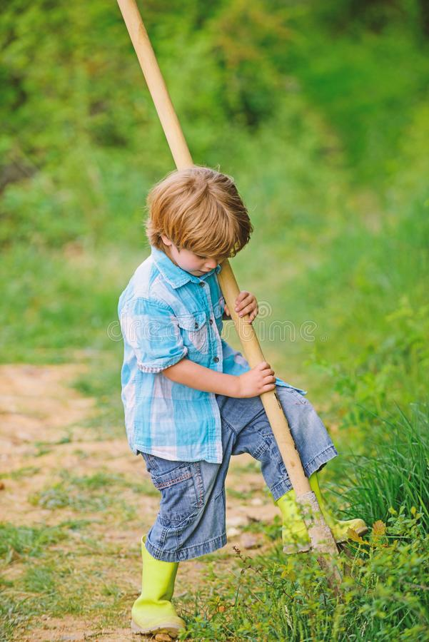 Ecology and environmental protection. earth day. farming equipment. summer fun. happy child gardener. spring country. Side village. little kid having fun royalty free stock photo