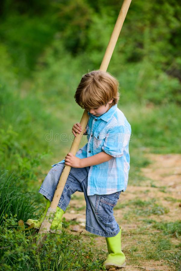 Ecology and environmental protection. earth day. farming equipment. summer fun. happy child gardener. spring country. Side village. little kid having fun stock photo