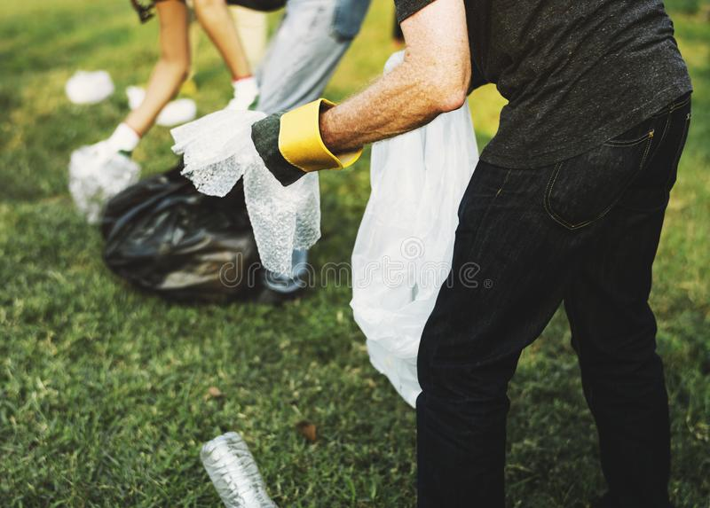 Ecology group of people cleaning the park royalty free stock photo