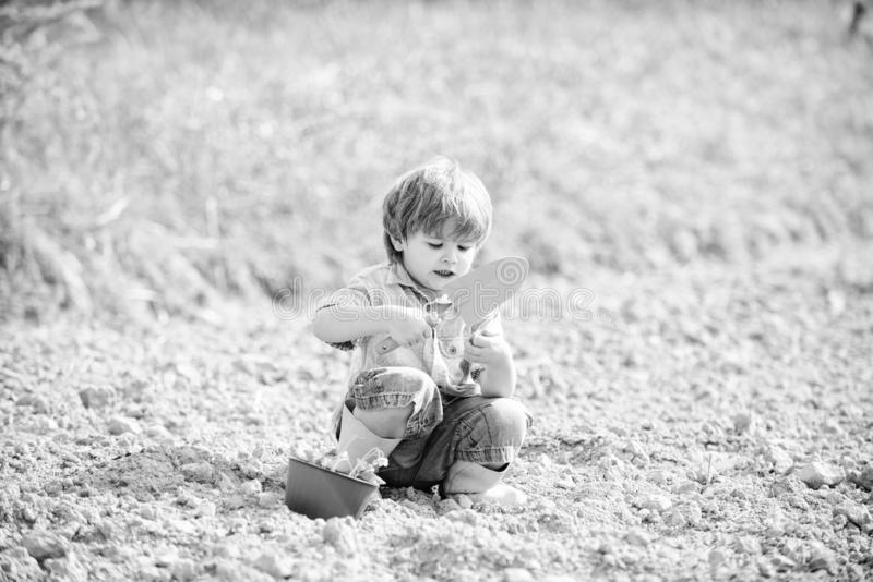 Ecology life. Cultivation concept. small kid planting a flower. earth day. new life. summer farm. farming and. Agriculture. happy child gardener. botanic worker royalty free stock photo
