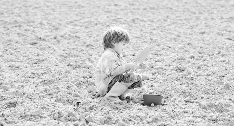 Ecology life. eco farm. human nature. earth day. new life. summer farm. small kid planting flower. happy child gardener. Botanic worker. Spring season. health royalty free stock photography