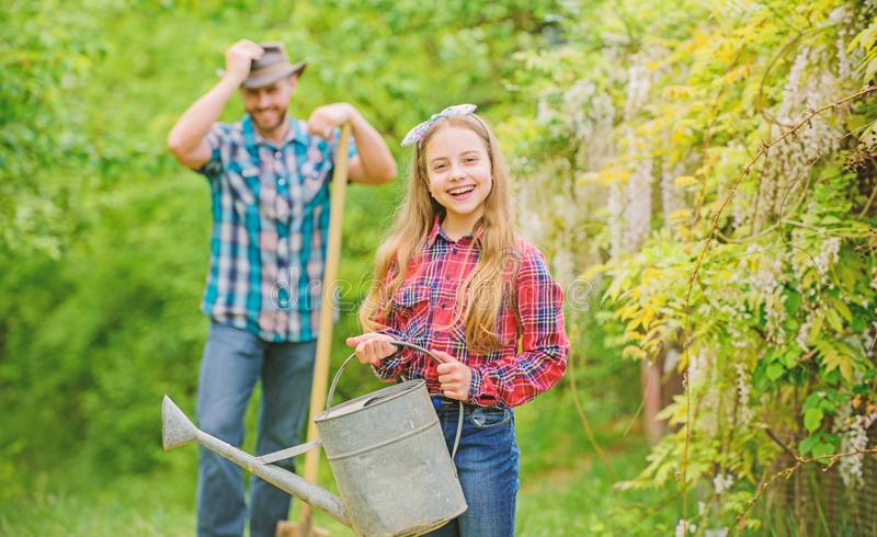 Ecology. Watering can and shovel. spring village country. family farm. little girl and happy man dad. earth day. father stock photography