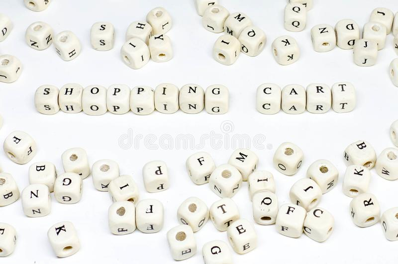 Ecommerce email blogging online advertising and social media marketing term wooden abc shopping cart royalty free stock photo