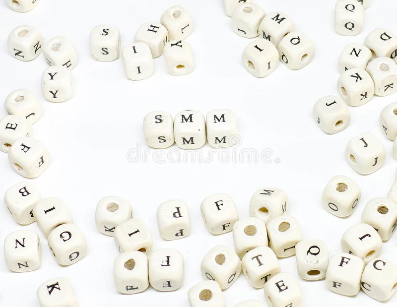 Ecommerce email blogging online advertising and social media marketing term wooden abc smm royalty free stock photo