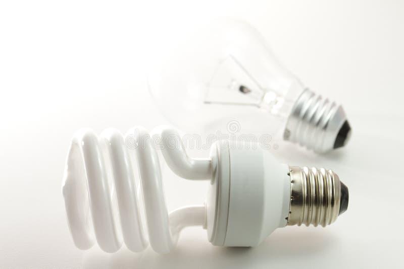 Economia de energia Incandescent e fluorescente imagens de stock royalty free