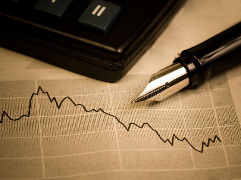 Economic crisis. Business concept. The calculator, pen and diagram royalty free stock image