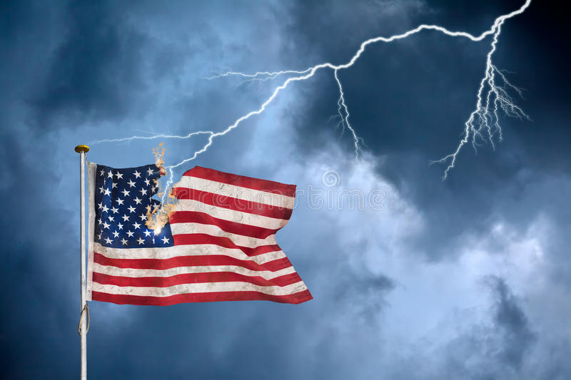 Economic crisis concept with the US flag struck by lightning. Concept of the economic crisis with the American flag struck by lightning stock photography