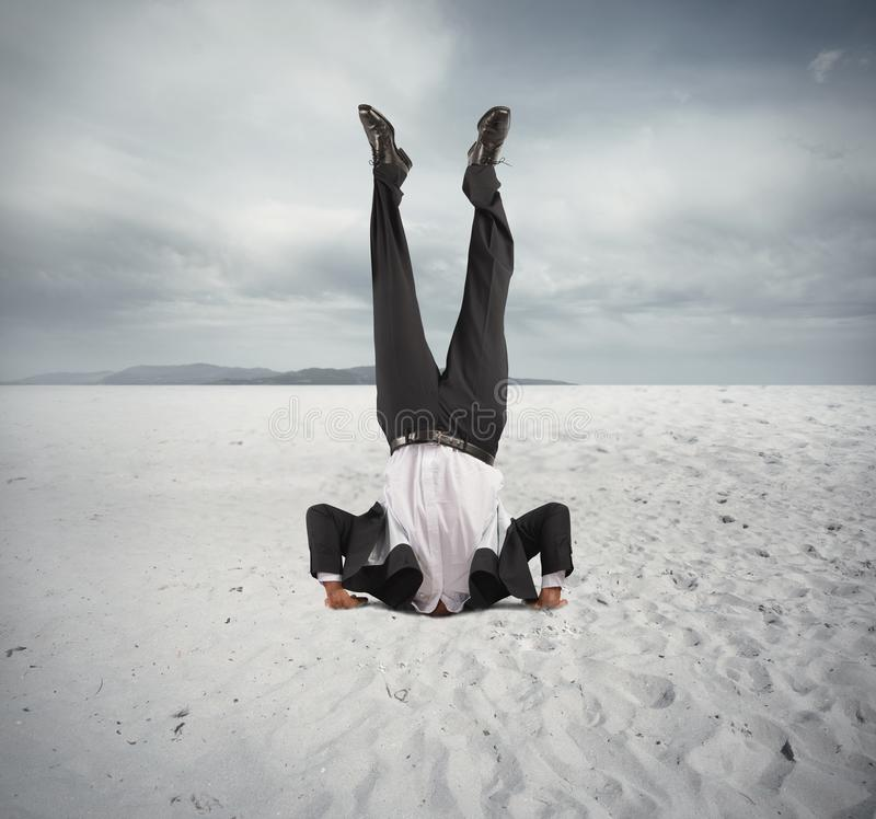 Economic downfall. Concept of economic downfall with businessman upside down stock images