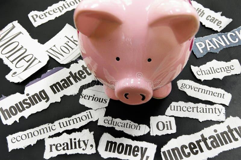 Economic news. Torn newspaper headlines showing bad news with piggy bank stock photo