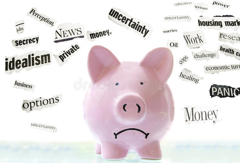 Economic news. Frowning pink piggy bank with bad economic news headlines stock images
