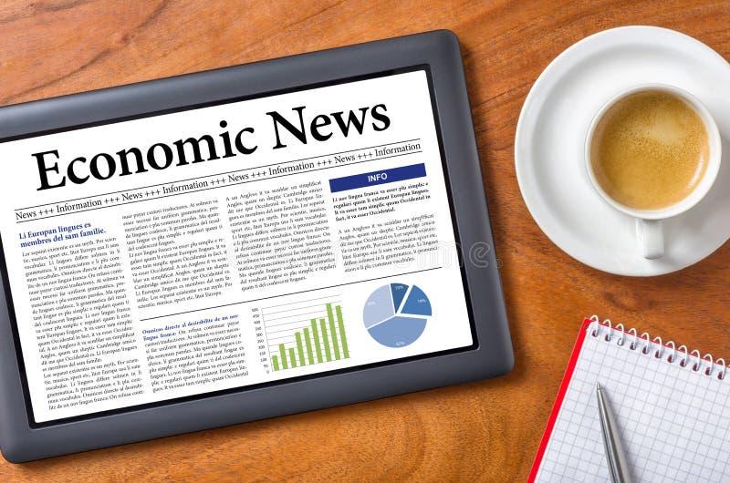 Economic News. Tablet on a desk - Economic News royalty free stock photography