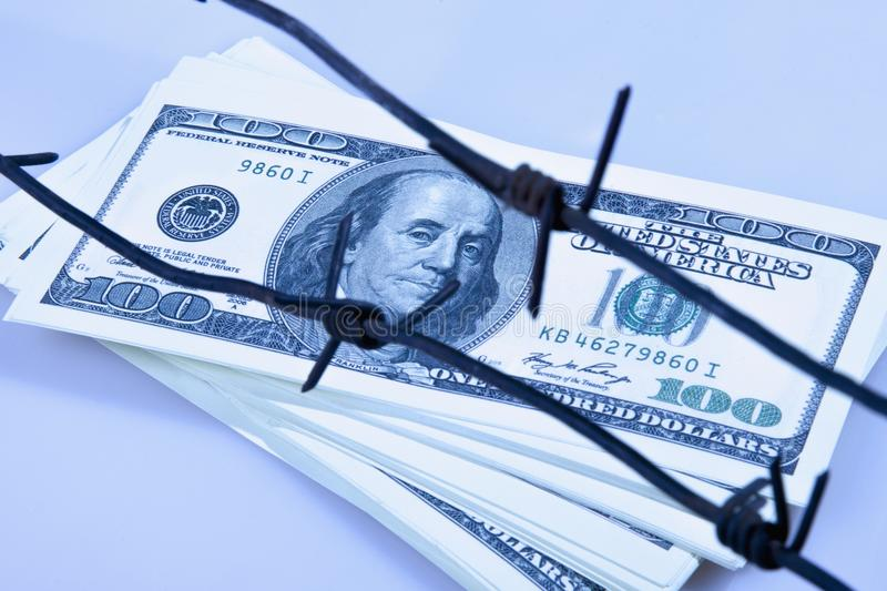 Economic warfare, sanctions and embargo busting concept. US Doll royalty free stock image