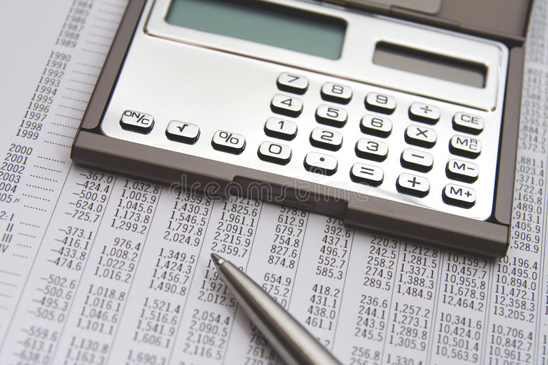 Economist. In action - economic sheet, calculator and pen stock photo