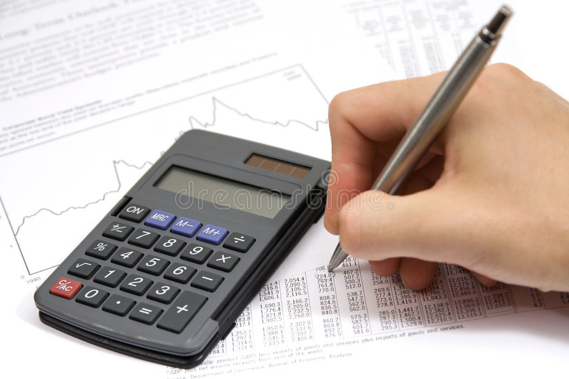 Economist. In action - economic sheet, graph, calculator and pen stock image