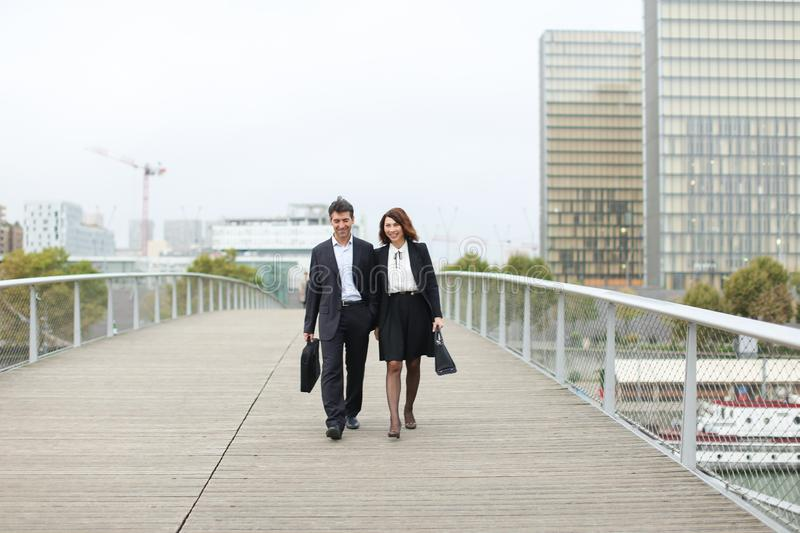 economists male and female in strict suits walking. royalty free stock photos