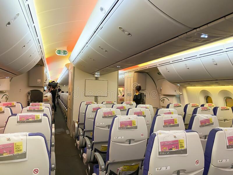 Economy class with empty seats of Scoot Airline is a Singaporean low-cost airline which is a subsidiary of Singapore Airlines. royalty free stock photography