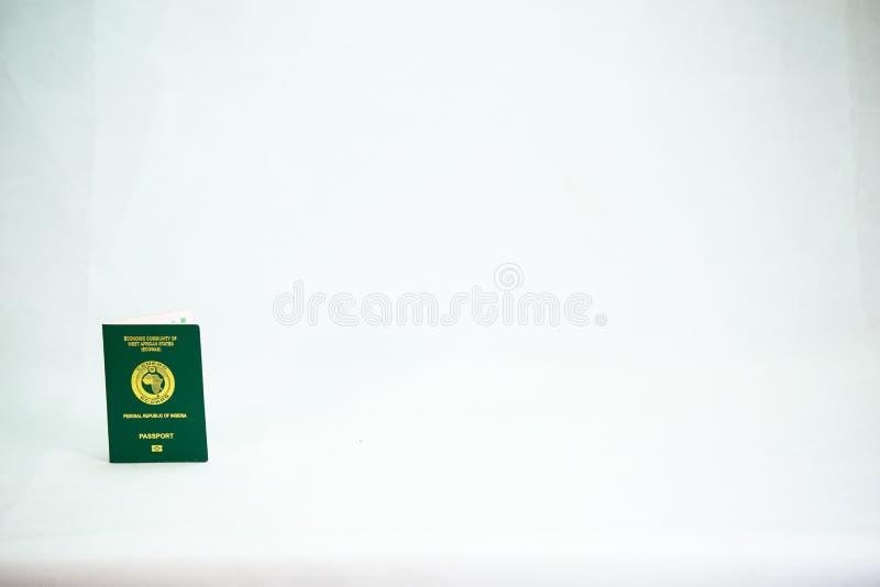 Ecowas尼日利亚在白色背景的国际性组织护照 库存图片