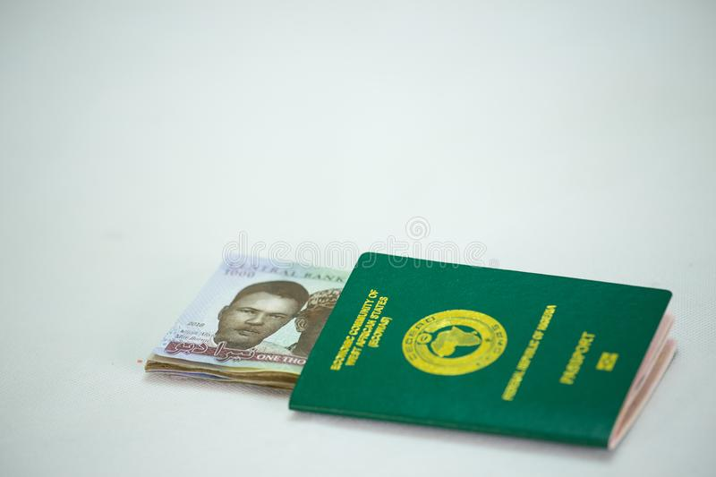 Ecowas Nigeria International Passport with 1000 naira currency notes stock images