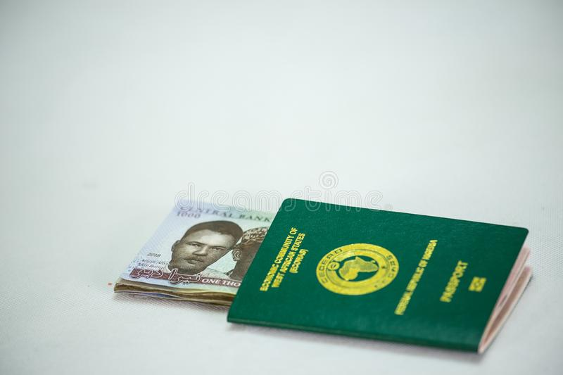 Ecowas Nigeria International Passport with 1000 naira currency notes stock image