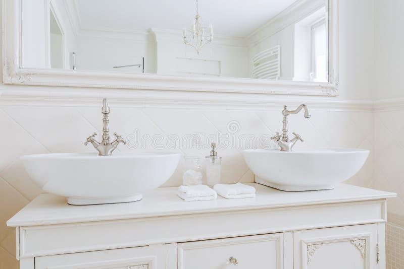 Ecru washbasins for big family stock image