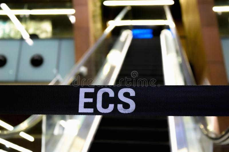 ECS word on strip at elevator entrance closed unfocused stock photo