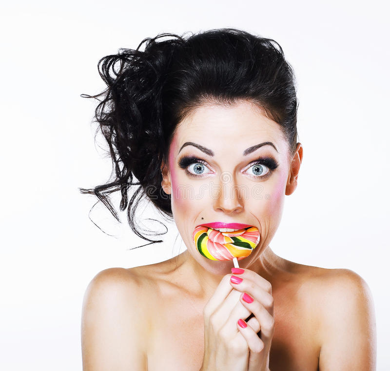 Free Ecstasy. Funny Peppy Woman With Yummy Lollipop Stock Image - 33135041