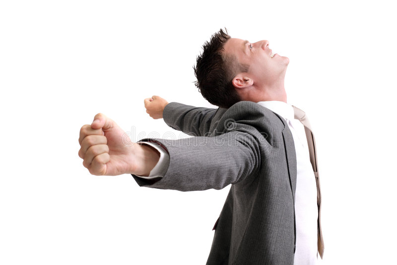 Ecstatic!. Young successful businessman with arms outstretched celebrating success royalty free stock image