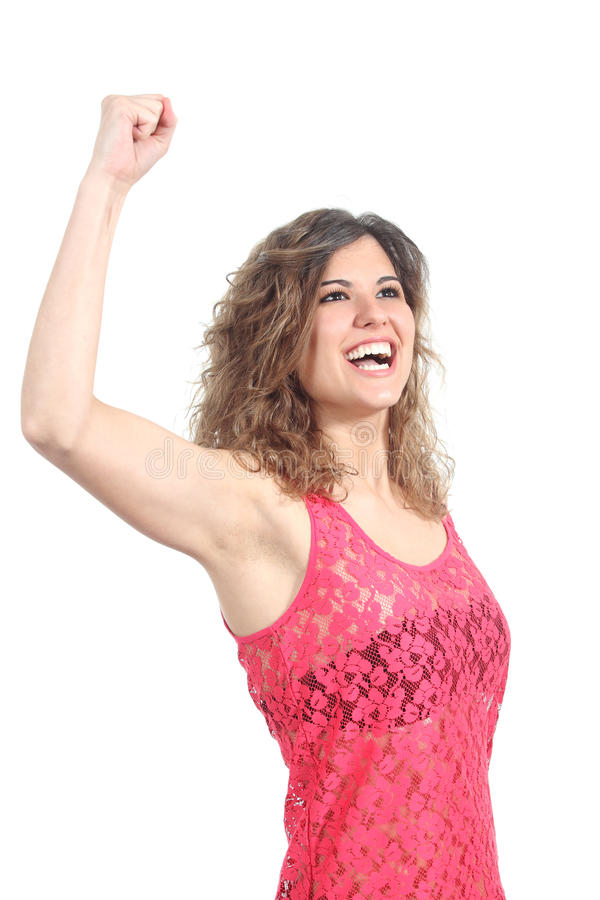 Ecstatic beautiful girl with her arm raised. Isolated on a white background stock images