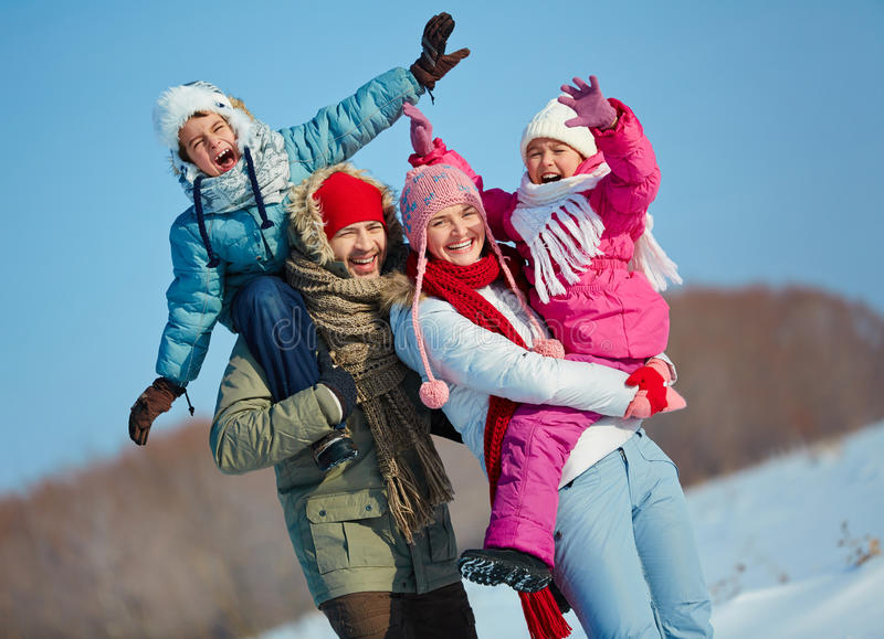 Ecstatic family. Looking at camera in winter royalty free stock photo