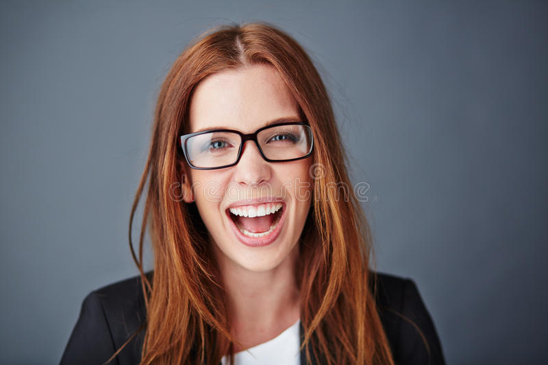 Ecstatic secretary. Ecstatic young businesswoman in eyeglasses looking at camera stock photo