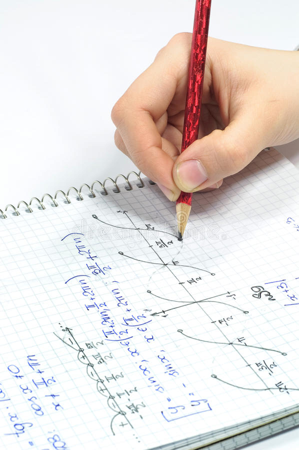 Ecuaciones de la álgebra de la escritura de la mano imagen de archivo