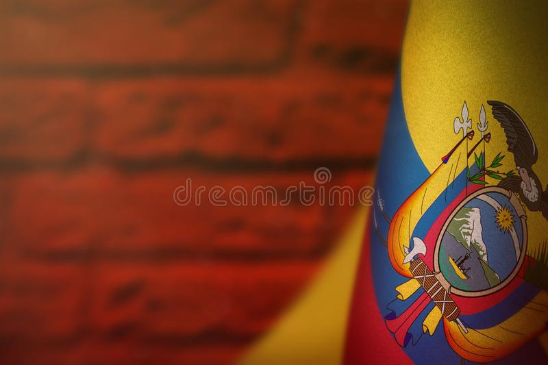 Ecuador flag for honour of veterans day or memorial day. Glory to the Ecuador heroes of war concept on red blurred painted brick. Ecuador hanging flag for honour vector illustration