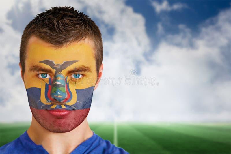 Ecuador football fan in face paint stock image