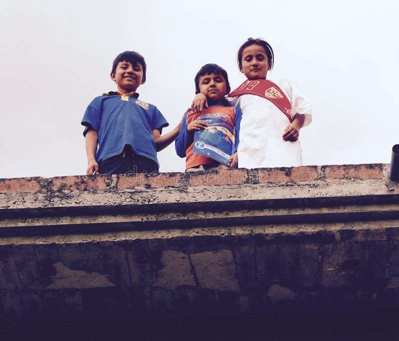 Ecuadorian Children on a roof Vilcabamba stock photography