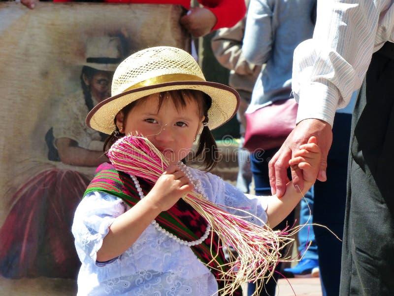 Ecuadorian girl in traditional dress and panama ha with srawt stock photo