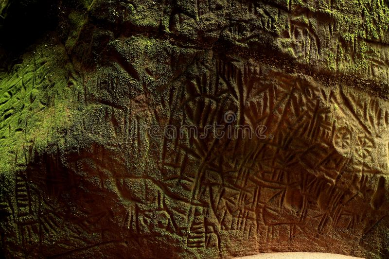 Edakkal cave-Petroglyph , Wayanad, Kerala. Edakkal Caves are two natural caves at a remote location at Edakkal, 25 km from Kalpetta in the Wayanad district of stock photo