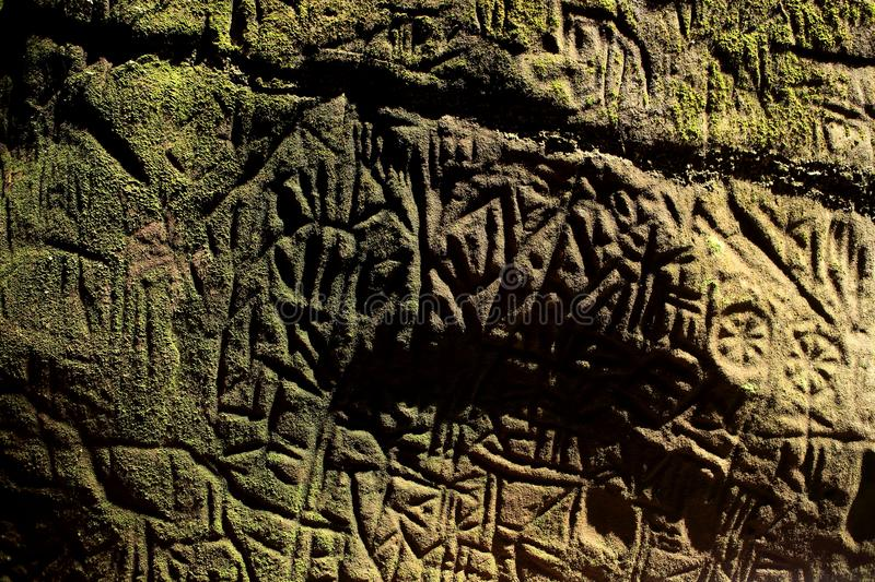 Edakkal cave-Petroglyph , Wayanad, Kerala. Edakkal Caves are two natural caves at a remote location at Edakkal, 25 km from Kalpetta in the Wayanad district of royalty free stock photography