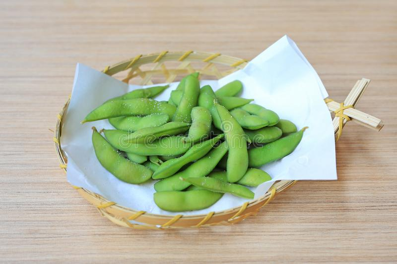 Edamame nibbles, boiled green soy beans, Japanese food royalty free stock photos
