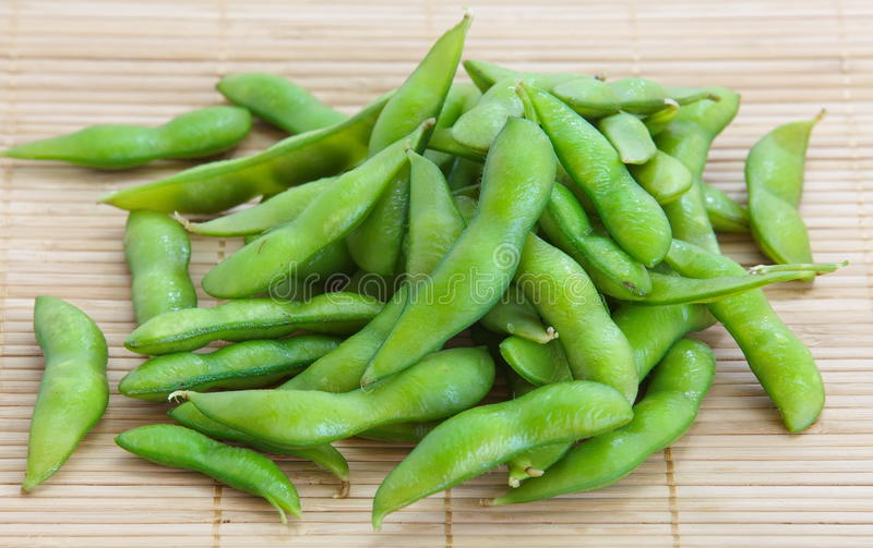 Edamame nibbles, boiled green soy beans. Japanese food stock image