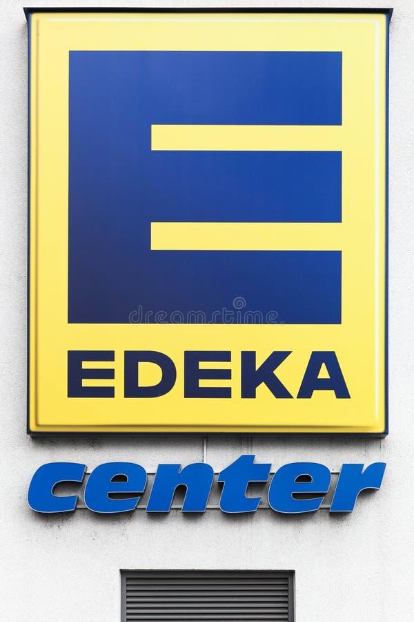 Edeka logo on a wall. Frechen, Germany - July 22, 2017: Edeka logo on a wall. The Edeka Group is the largest German supermarket corporation royalty free stock photography