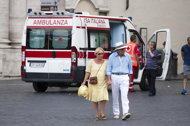 Ederly couple move away from ambulance stock photos