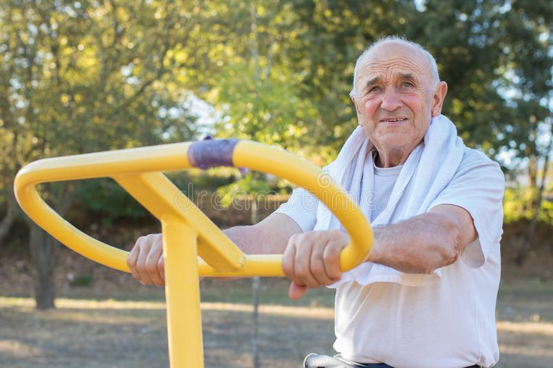 Ederly man doing outdoor sports royalty free stock images