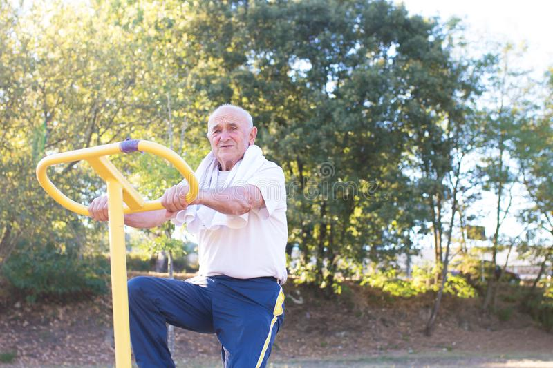 Ederly man doing outdoor sports stock photography