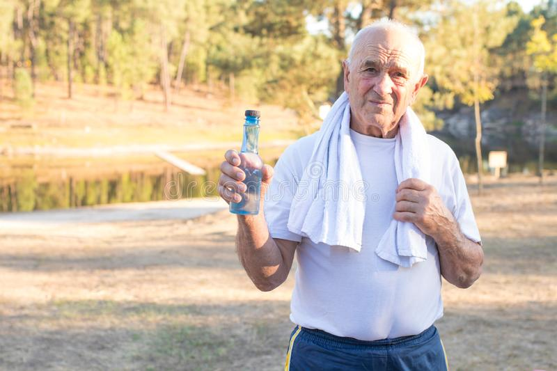 Ederly man doing outdoor sports royalty free stock image