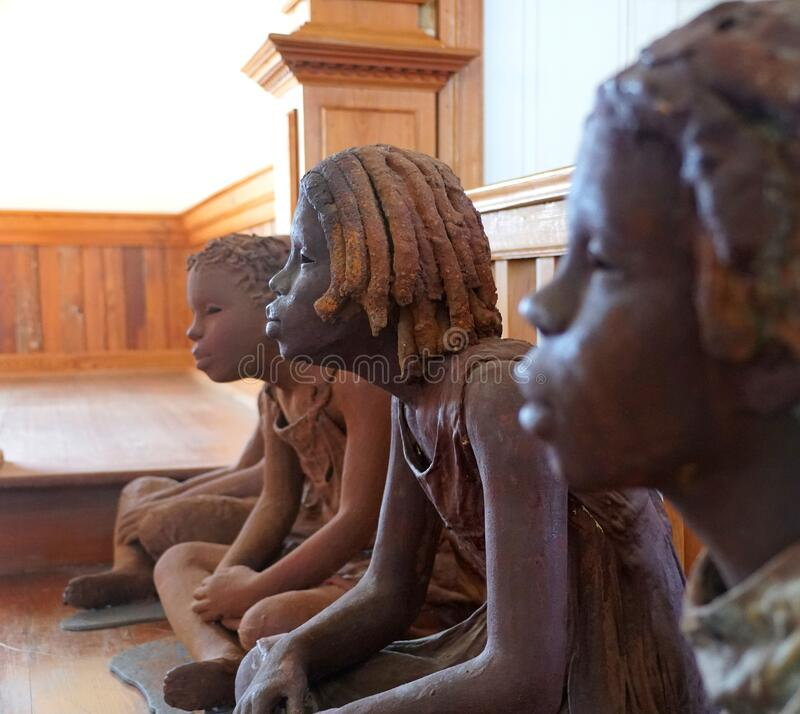 Edgard, Louisiana, U.S.A - February 2, 2020 - The statue of the African American girl inside the church near Whitney Plantation. Edgard, Louisiana, U.S.A stock photo