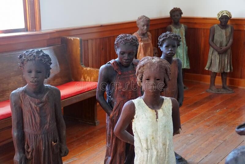 Edgard, Louisiana, U.S.A - February 2, 2020 - The statues of the African American kids inside the church near Whitney Plantation. Edgard, Louisiana, U.S.A royalty free stock photo