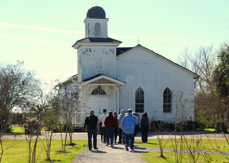 Edgard, Louisiana, U.S.A - February 2, 2020 - Visitors in front of the white church near Whitney Plantation royalty free stock images