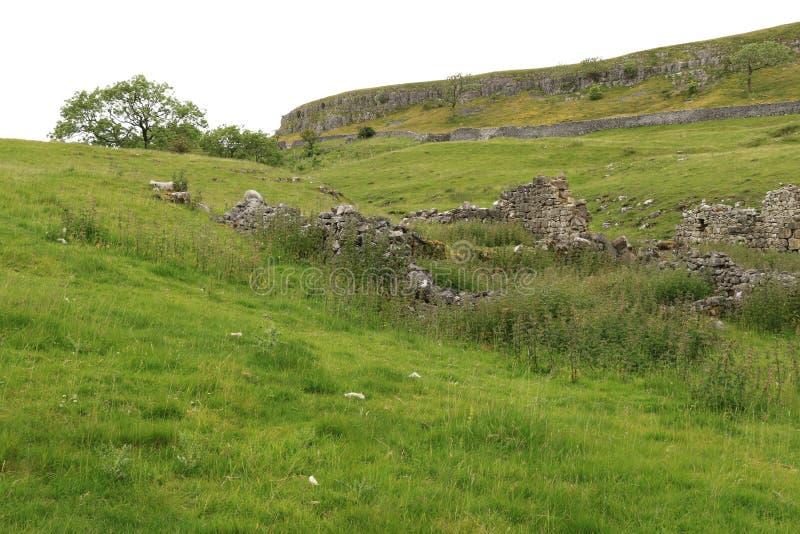 Cool Scar. The edge of Cool Scar near Kilnsey, beyond the scar lies a limestone quarry stock photo