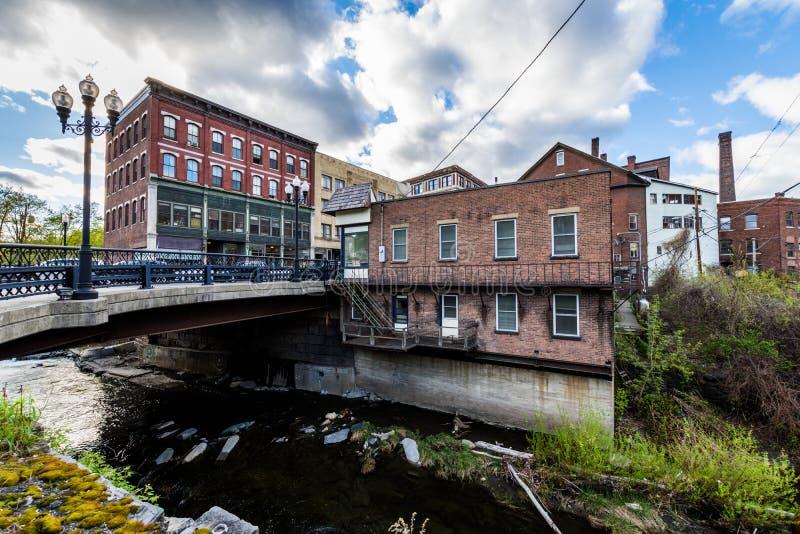 Edge of Downtown Brattleboro, Vermont above the Whetstone Brook. River royalty free stock photo