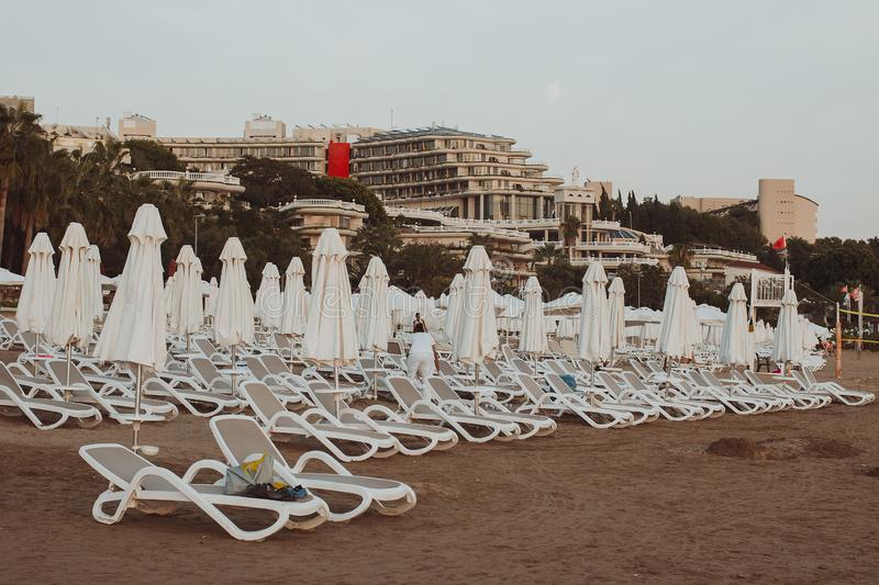 The edge Luxury swimming pool with white fashion deckchairs on the beach stock photo
